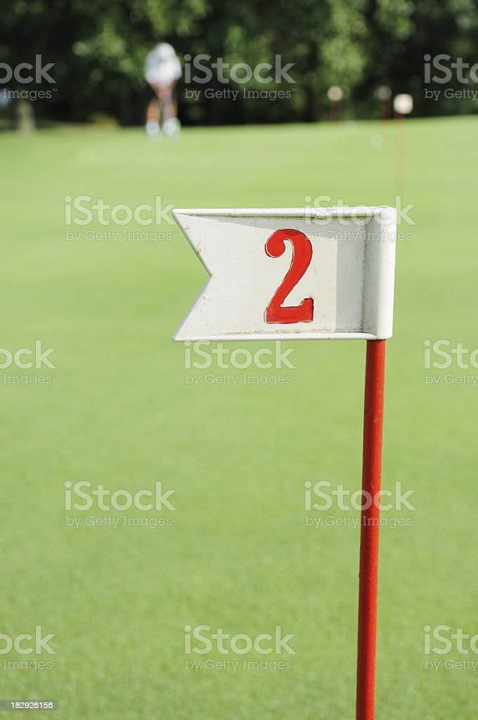 Flag 2 on practice green golf course royalty-free stock photo