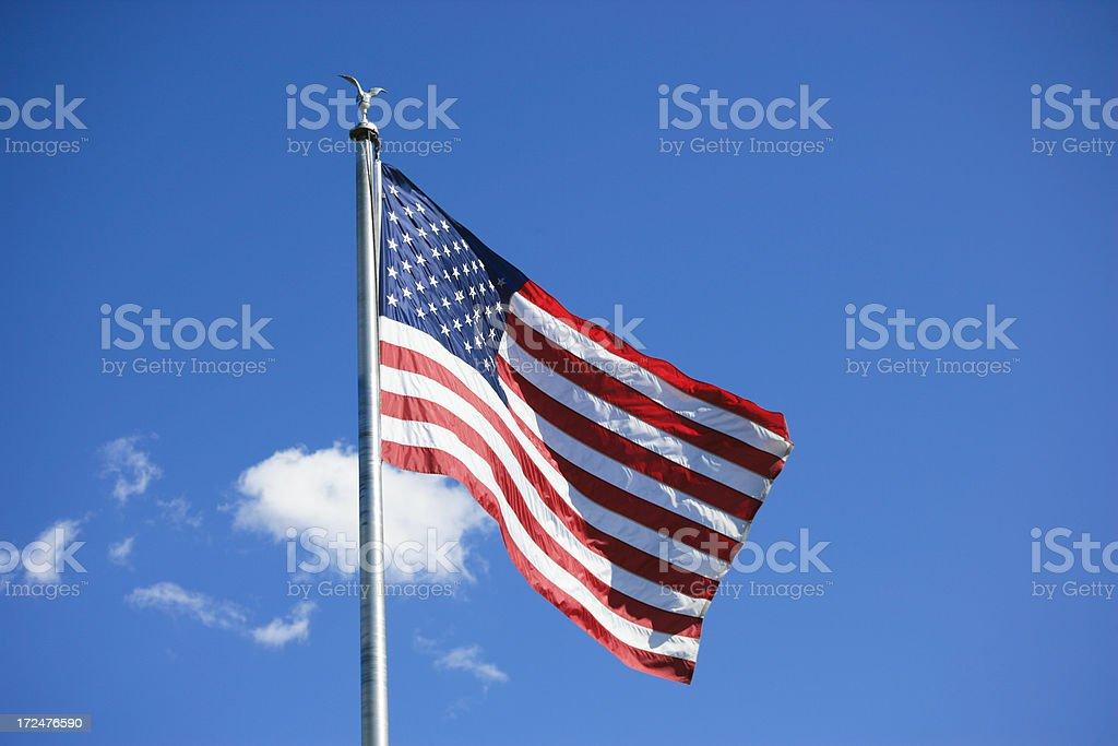 USA flag against blue sky stock photo