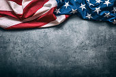 USA flag. American flag freely lying on concrete background.