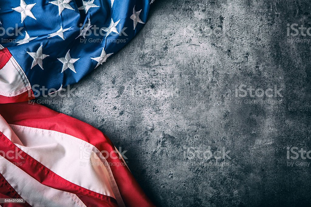 USA flag. American flag freely lying on concrete background. stock photo