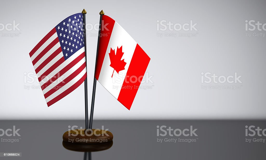 US Flag And Canadian Desk Flags stock photo