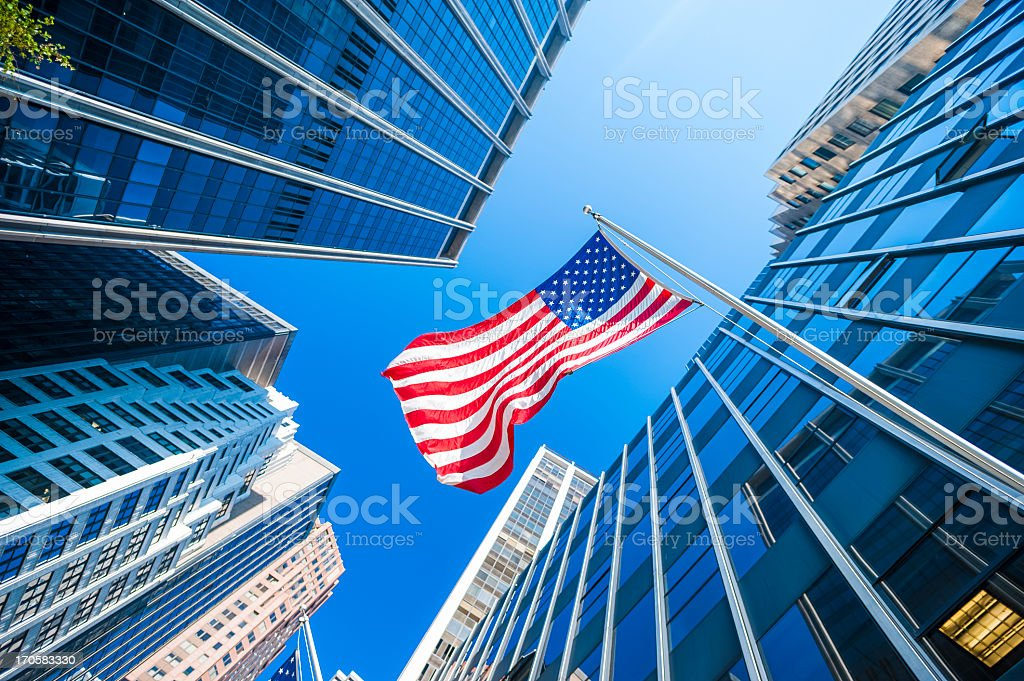 USA flag and contemporary glass skyscrapers in New York stock photo
