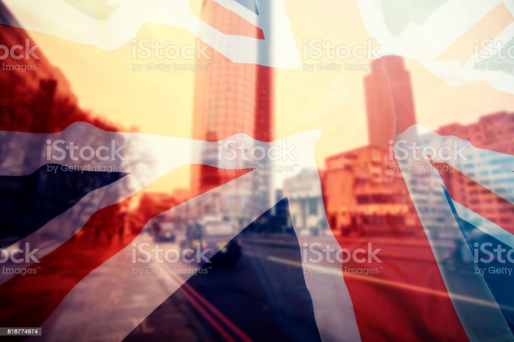 UK flag and financial buildings stock photo