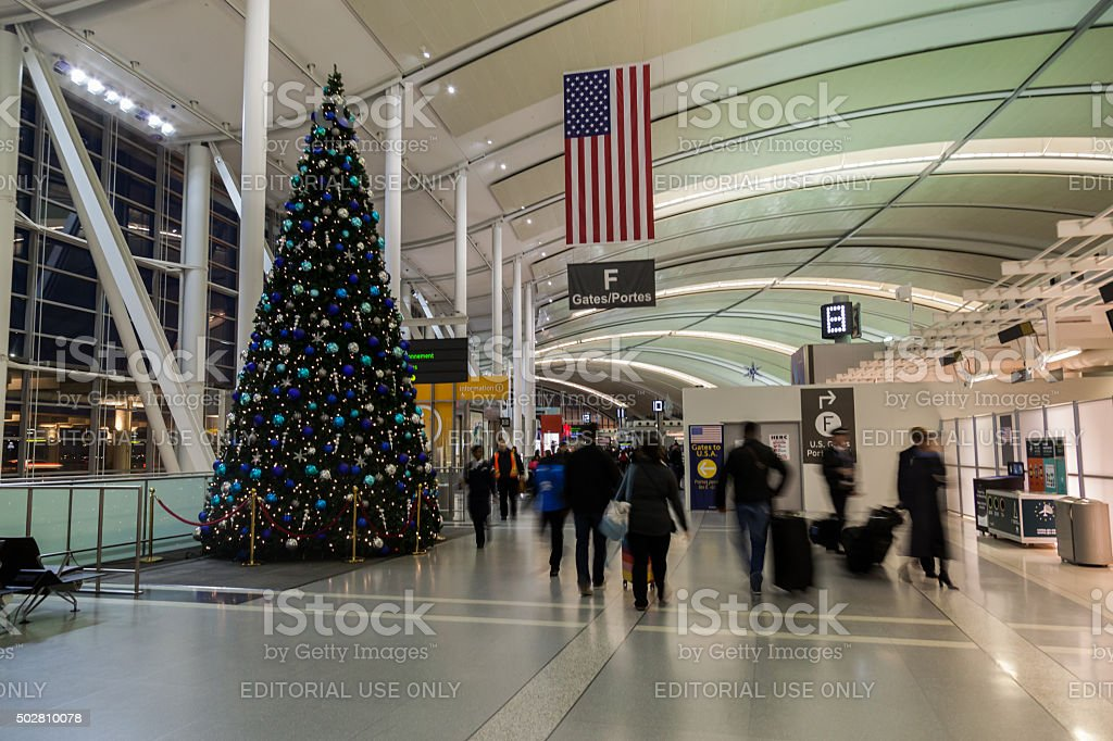 U.S.A. flag and gate number beside Christmas tree stock photo
