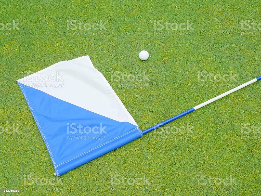 flag and golf ball stock photo