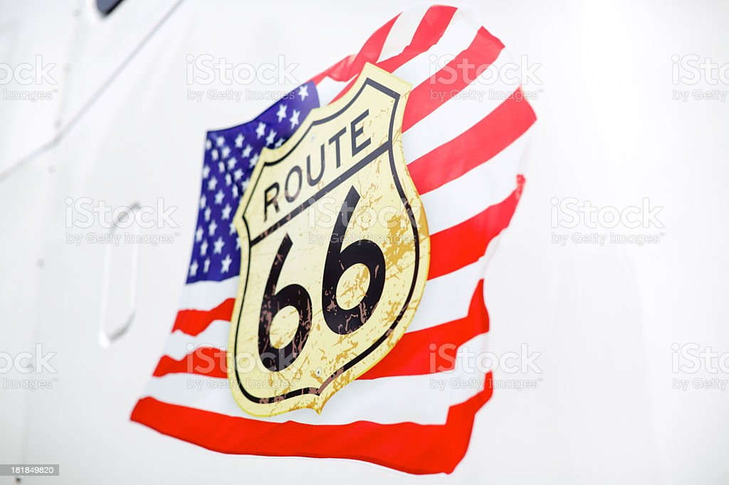 Flag and route 66 sign on white truck royalty-free stock photo