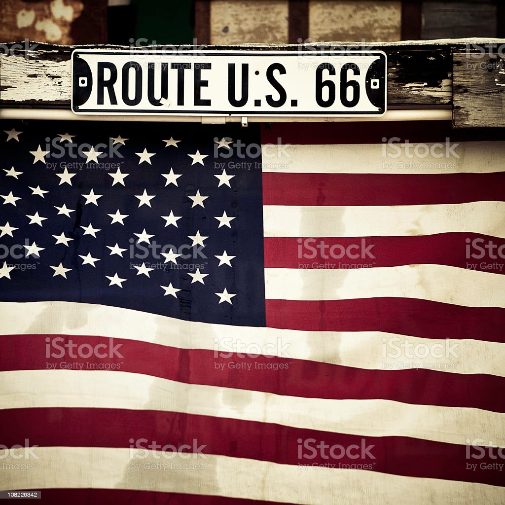 flag and route 66 sign stock photo