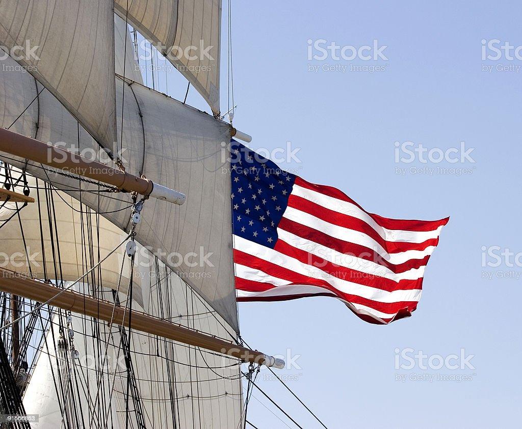 Flag and Tall Ship Sails royalty-free stock photo