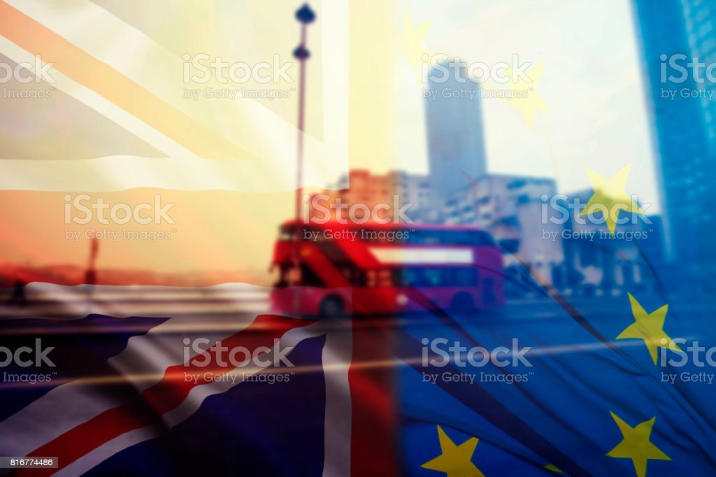 UK flag and typical red buses stock photo