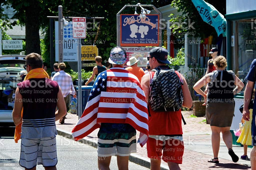 USA Flag as Beach Towel Over Man's Shoulders, Provincetown, Massachusetts stock photo