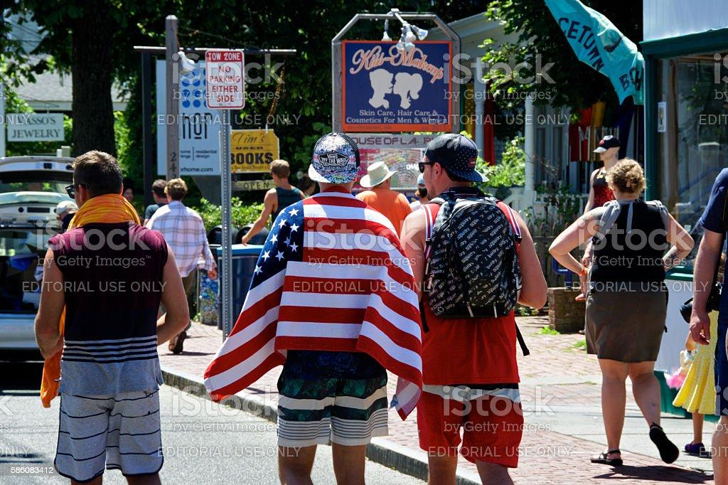 USA Flag as Beach Towel Over Man's Shoulders, Provincetown, Massachusetts stock photo
