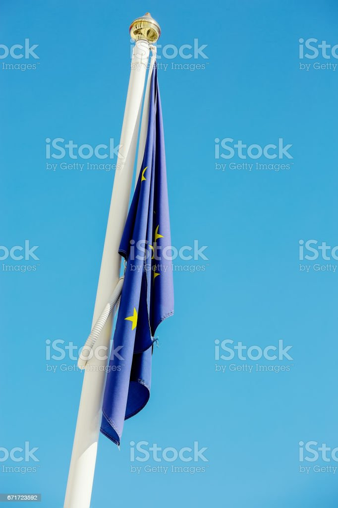 flag at half-mast illustrating a fall of european union stock photo