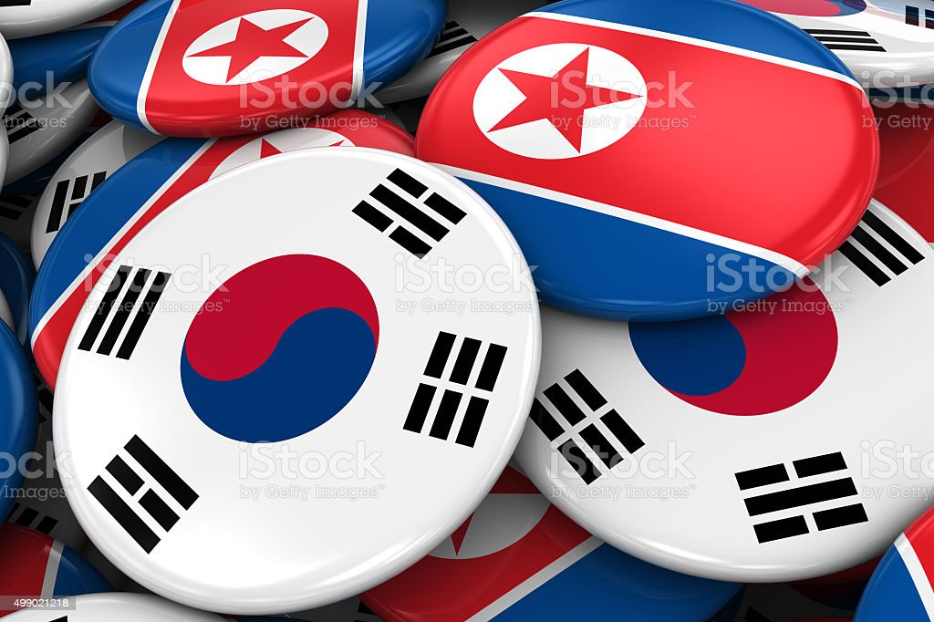 Flag Badges of South Korea and North Korea in Pile stock photo