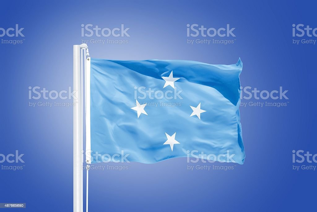 Flag Federated States of Micronesia flying against a blue sky stock photo