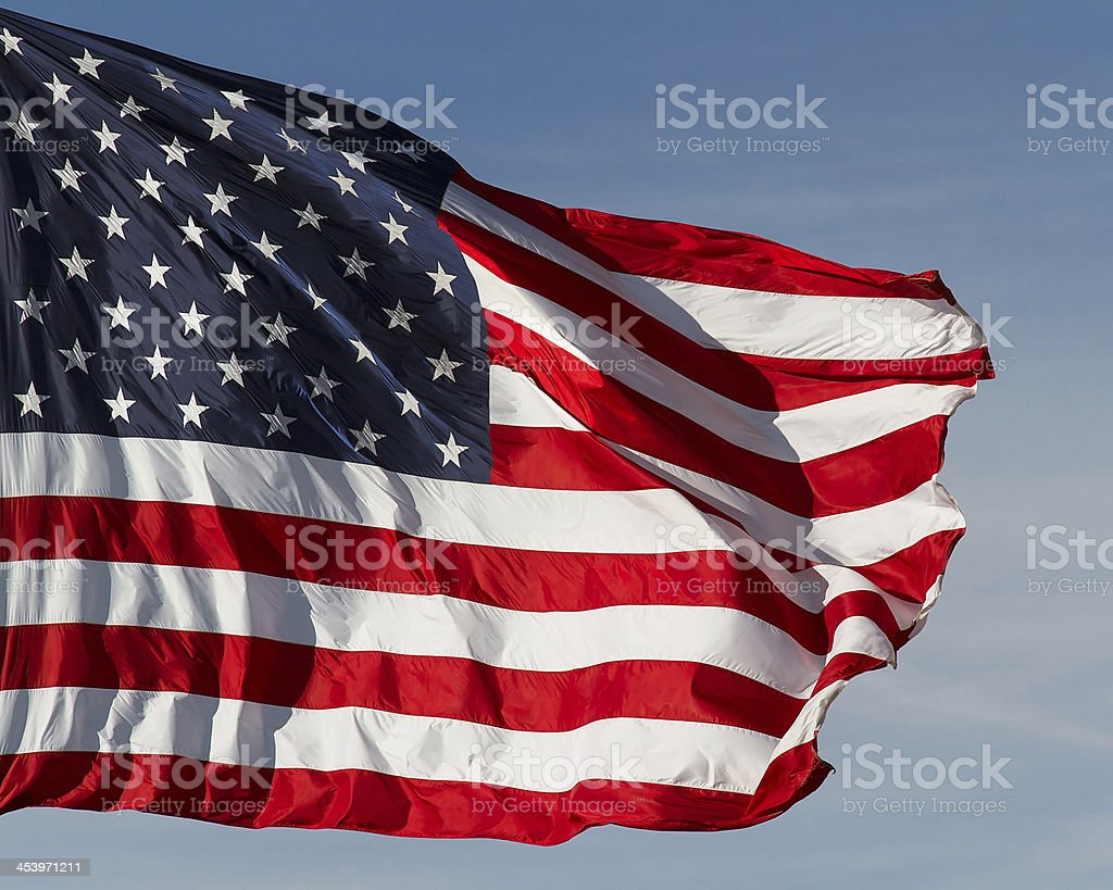 Bandiera US vola alto foto stock royalty-free
