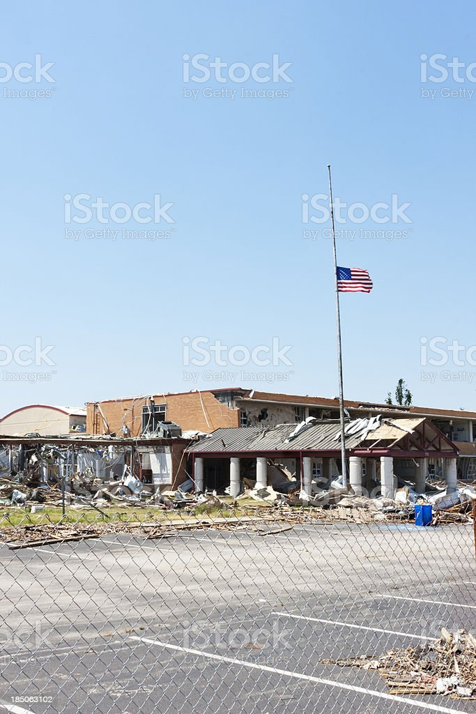 Flag Flies Outside a Tornado Damaged School royalty-free stock photo