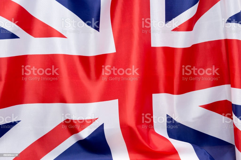 UK Flag flutters in the wind.The place to advertise, template. stock photo