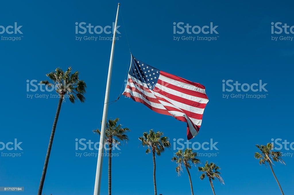 Flag flying at half-mast stock photo