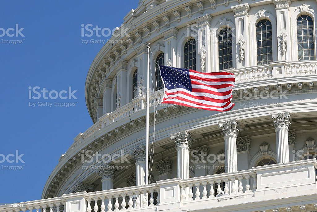 USA flag flying outside of Congress stock photo