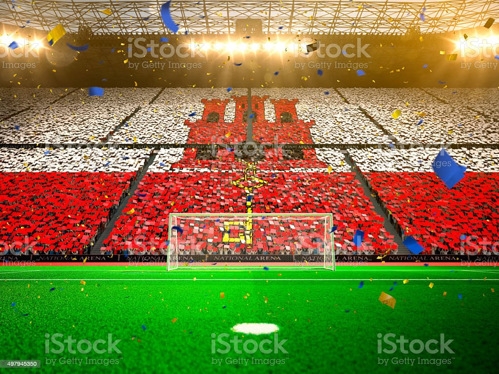 Flag Gibraltar of fans. Evening stadium arena Yellow stock photo