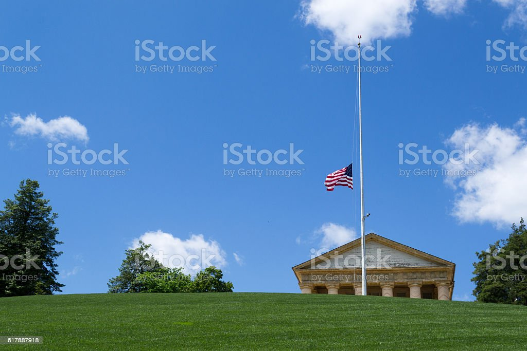 Flag half way up in Arlington Cemetery stock photo