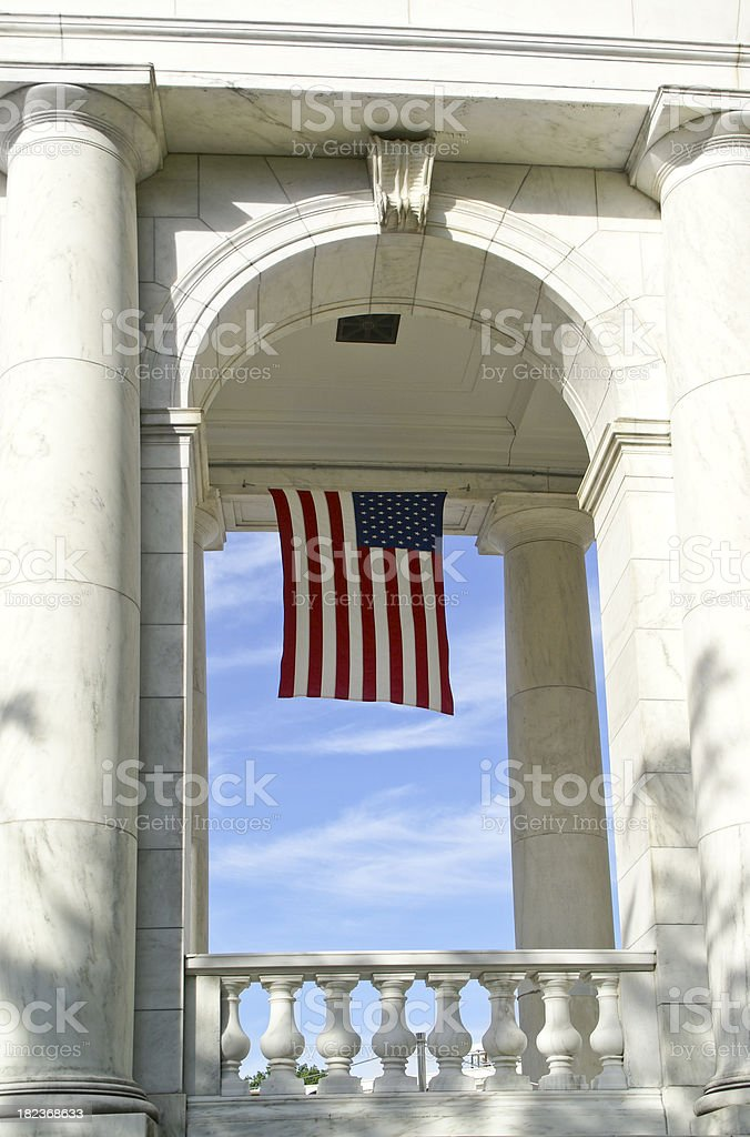 Flag hanging in Archway stock photo