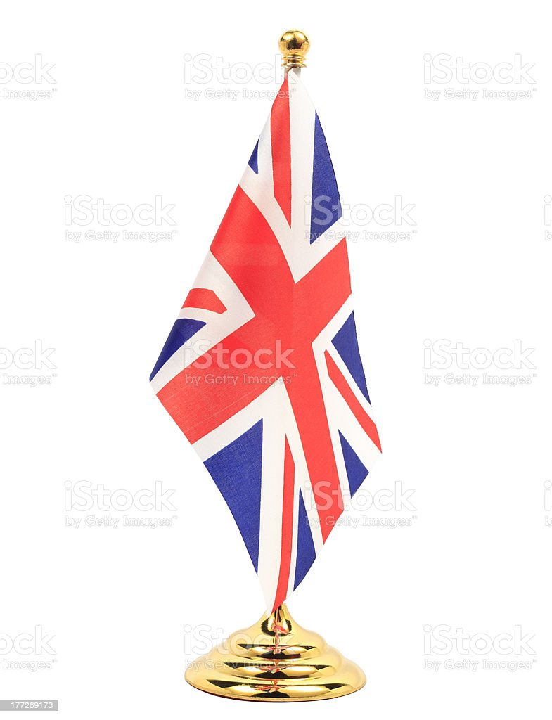 UK flag hanging on the golden flagstaff royalty-free stock photo