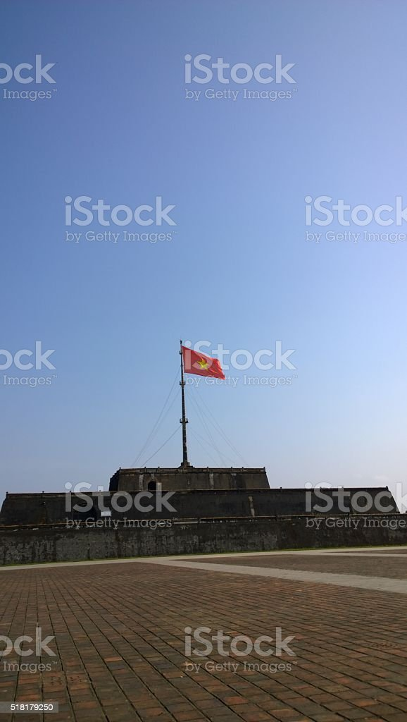 Flag in front of the Royal Palace in Huế Vietnam stock photo