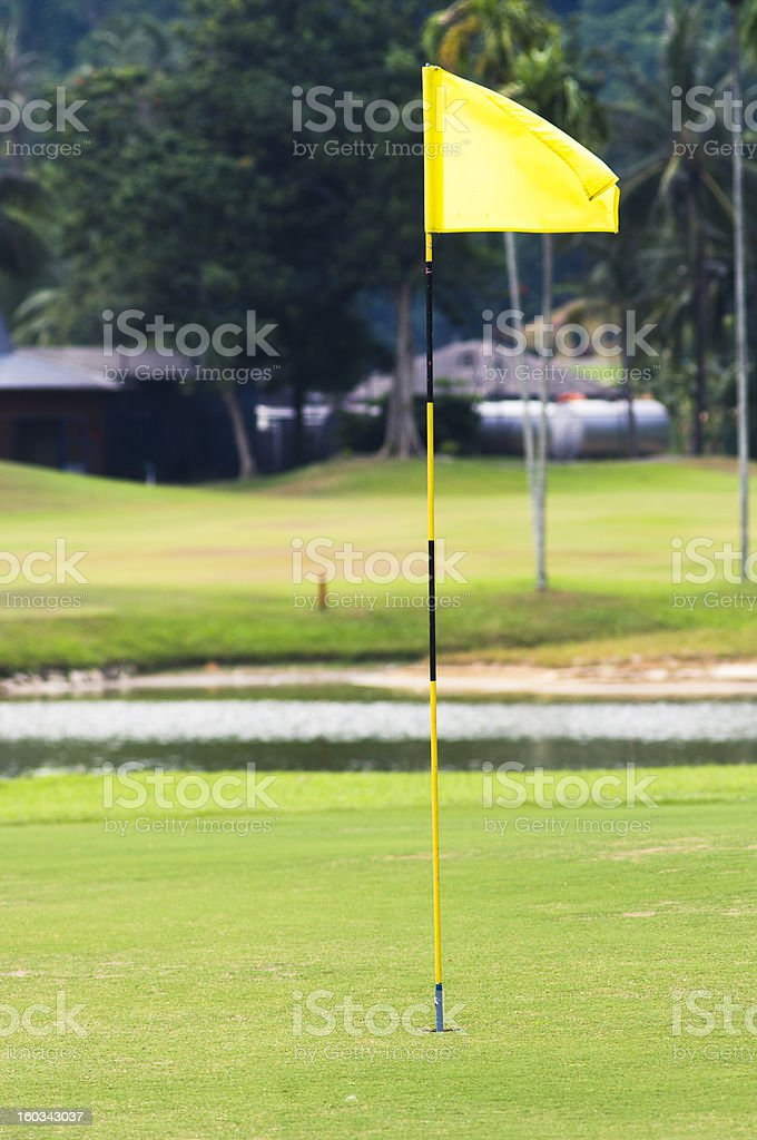 flag in hole of golf course royalty-free stock photo