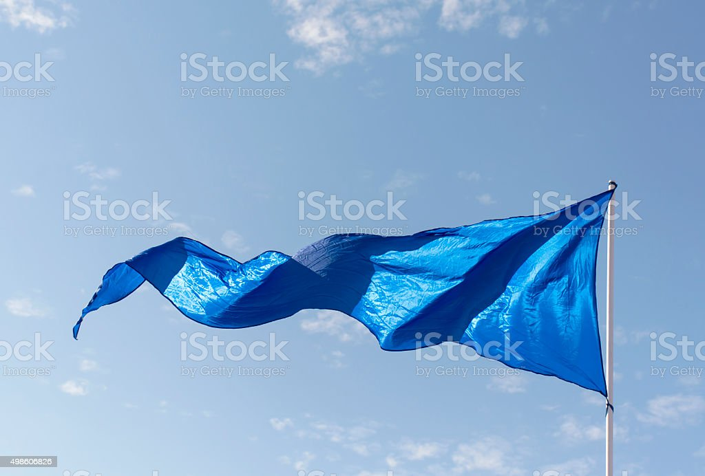 Flag in the wind stock photo