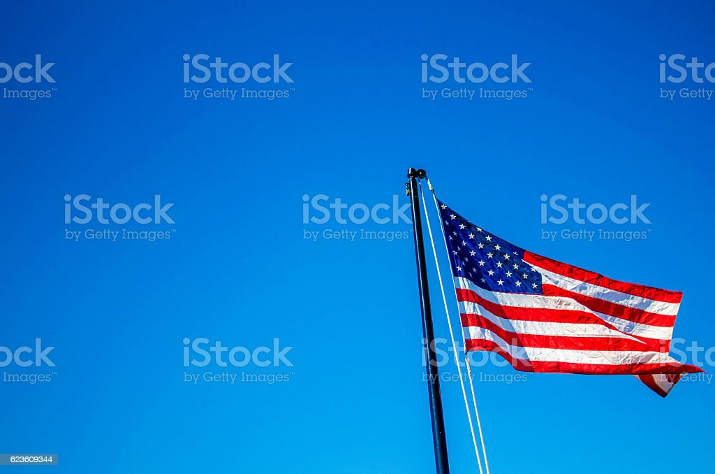 US Flag in thw wind stock photo
