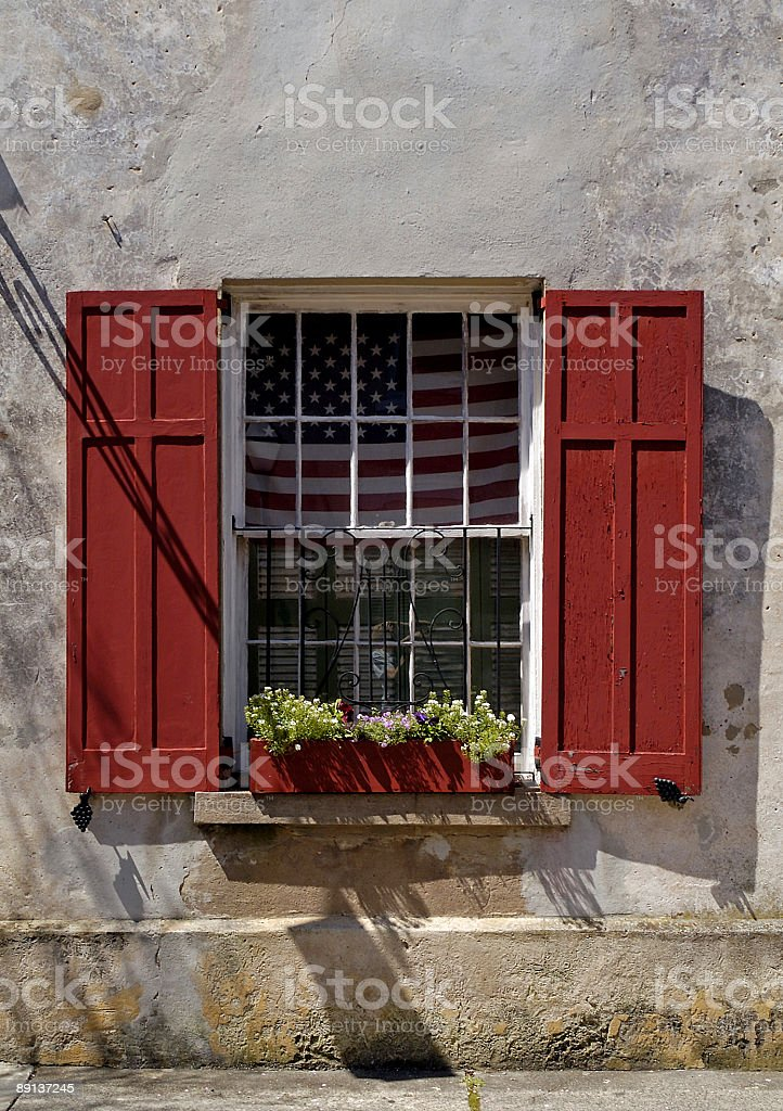 flag in window of old southern town royalty-free stock photo