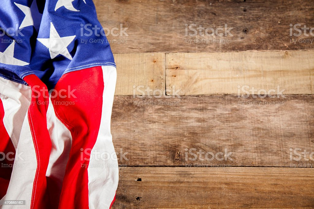 USA flag makes left border. Wooden boards background. stock photo