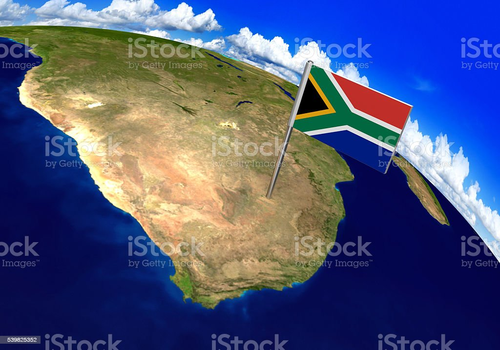 Flag marker over country of South Africa on world map stock photo