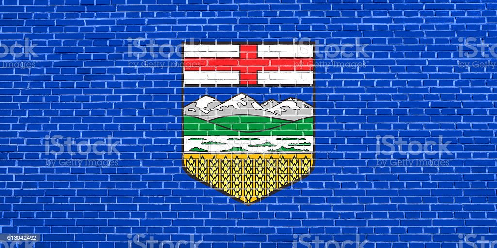 Flag of Alberta on brick wall texture background stock photo