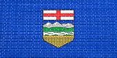 Flag of Alberta on brick wall texture background