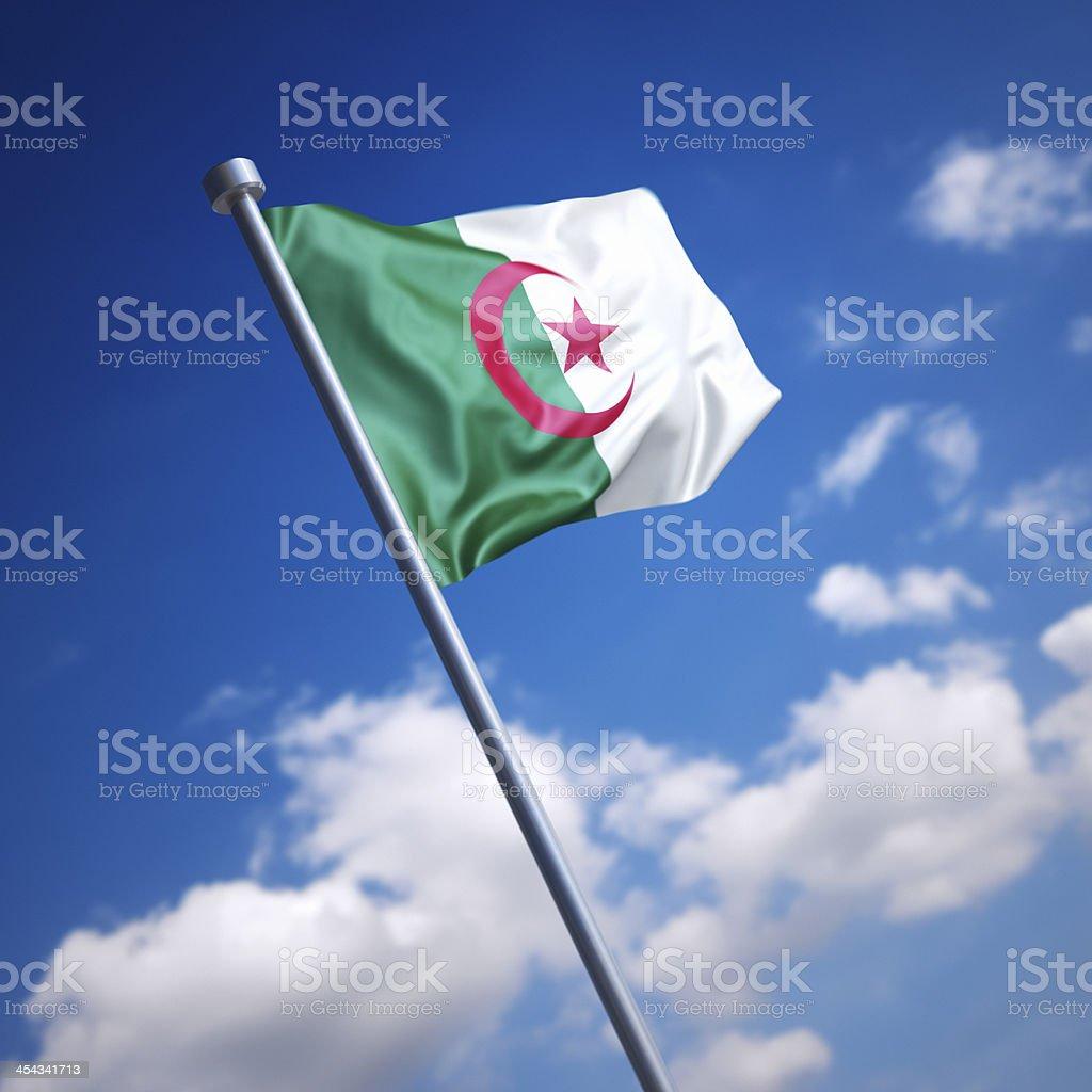 Flag of Algeria against blue sky stock photo