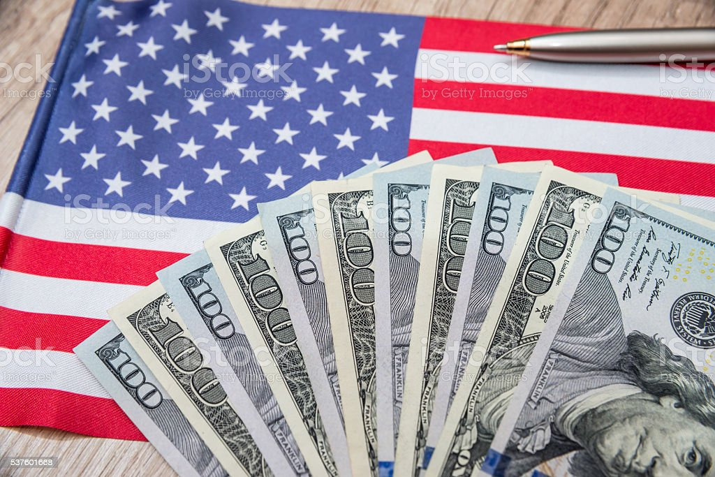 flag of america with money stock photo