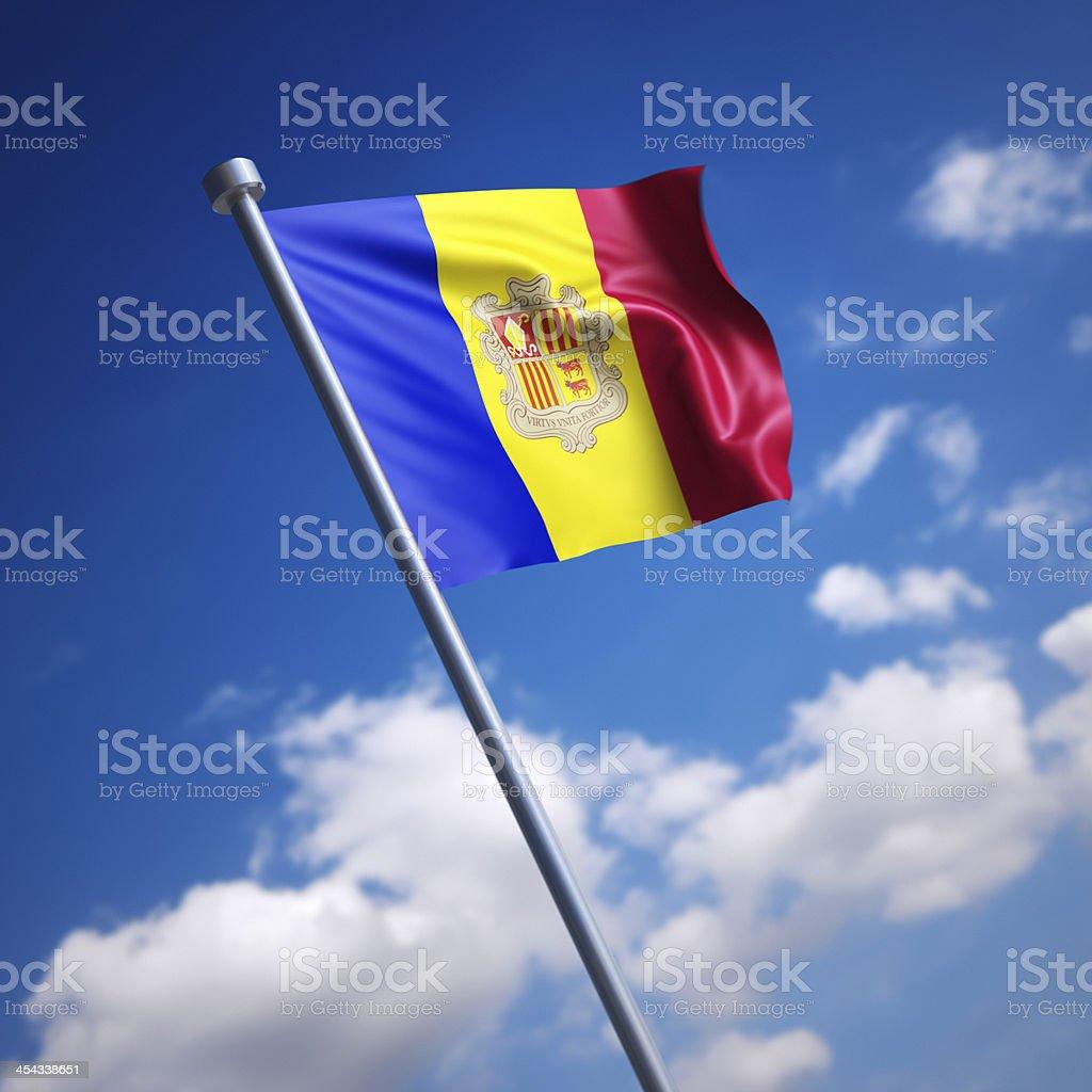 Flag of Andorra against blue sky stock photo