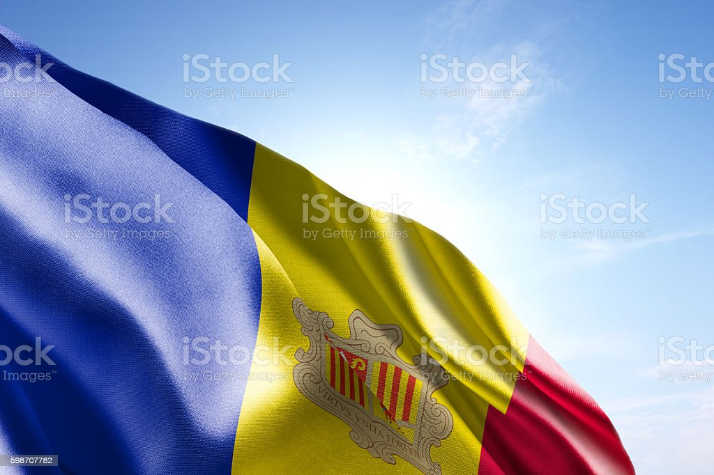 Flag of Andorra waving in the wind stock photo