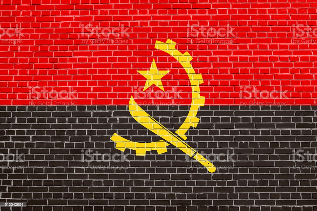 Flag of Angola on brick wall texture background stock photo