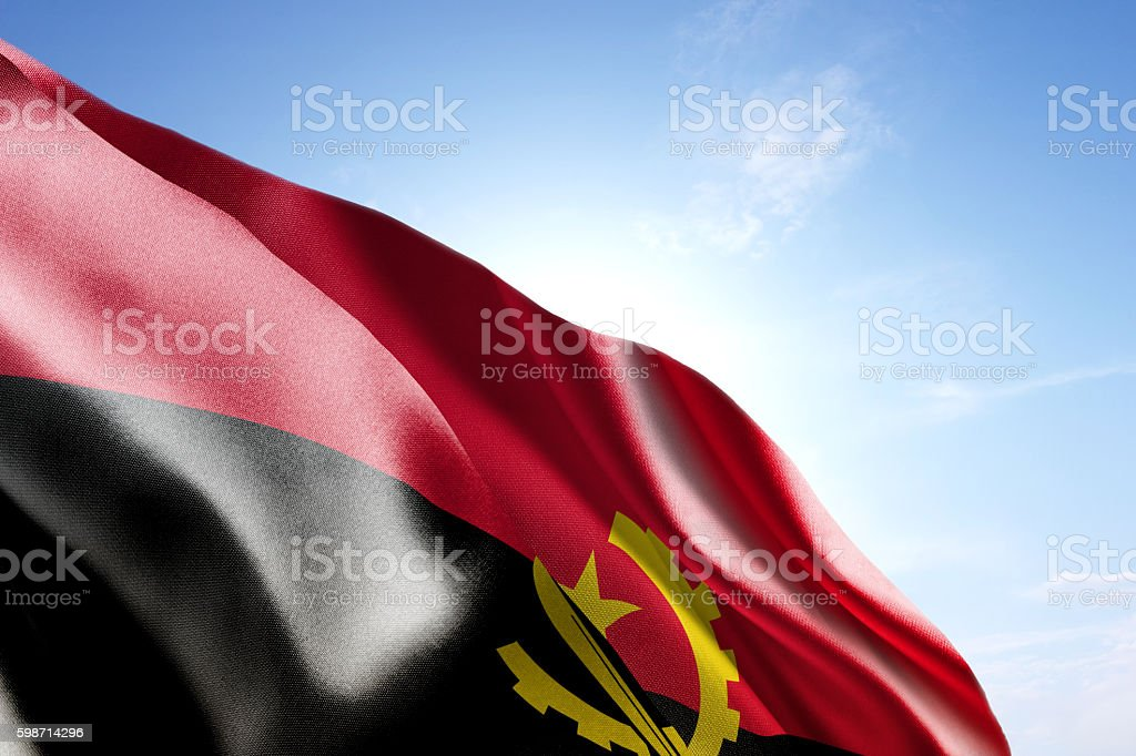 Flag of Angola waving in the wind stock photo