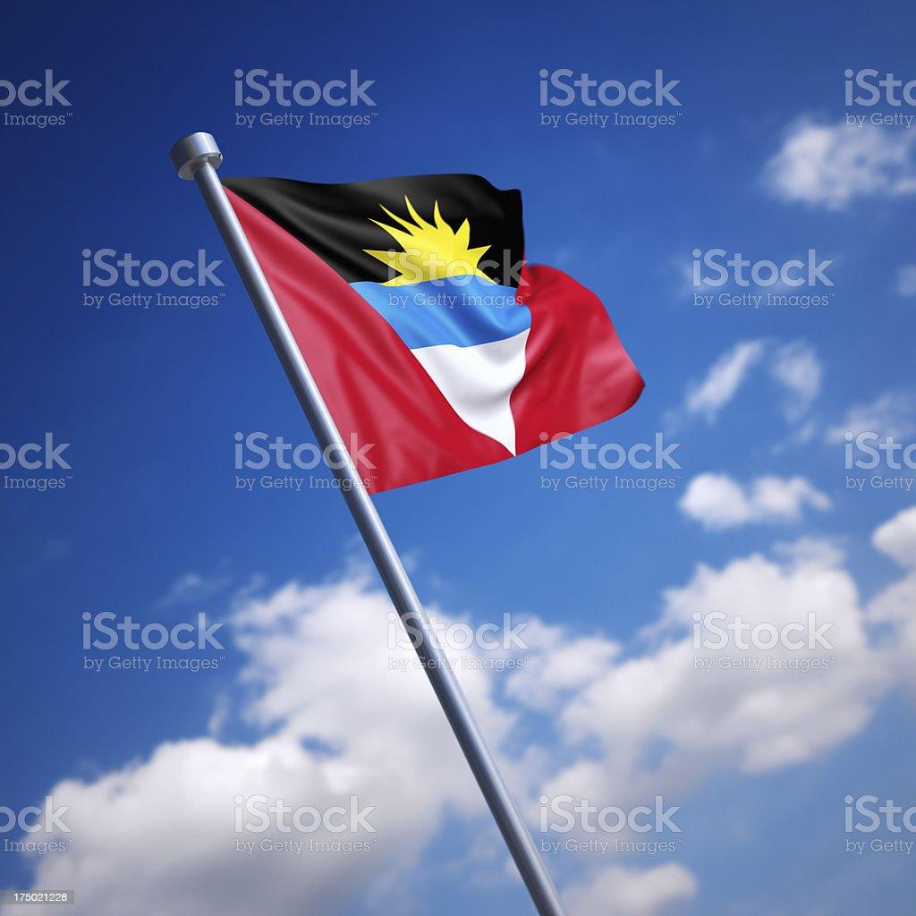 Flag of Antigua and Barbuda against blue sky stock photo