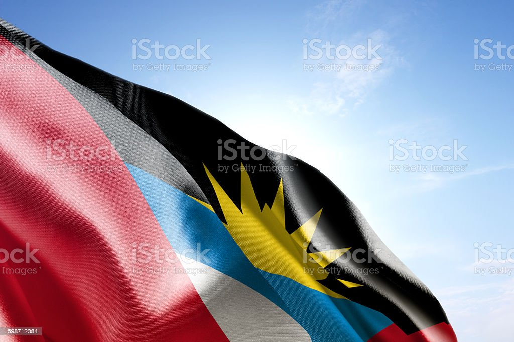 Flag of Antigua and Barbuda waving in the wind stock photo
