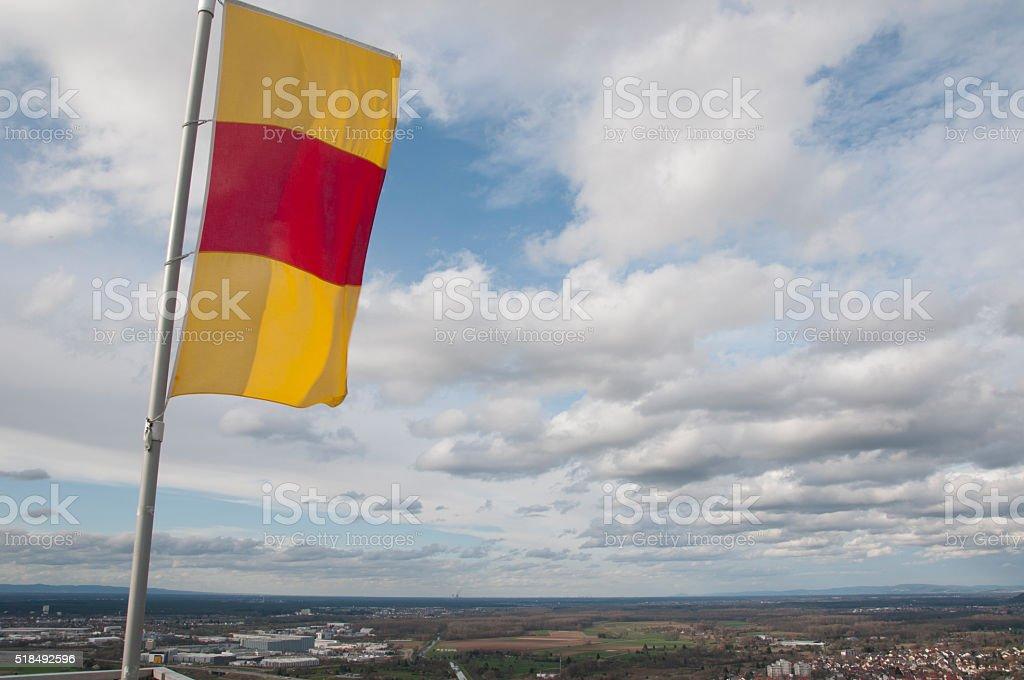 Flag of Baden-Wuerttemberg over the city of Karlsruhe stock photo