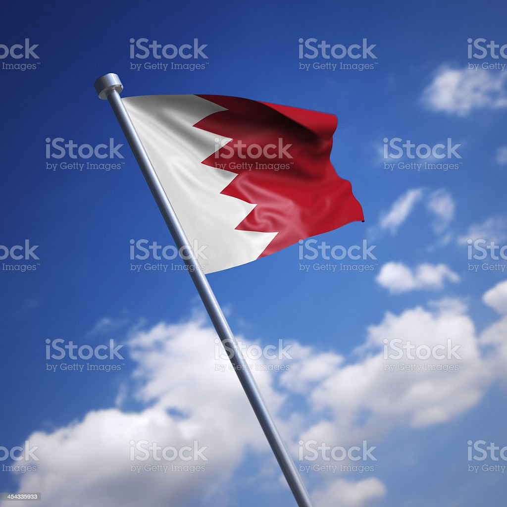 Flag of Bahrain against blue sky stock photo