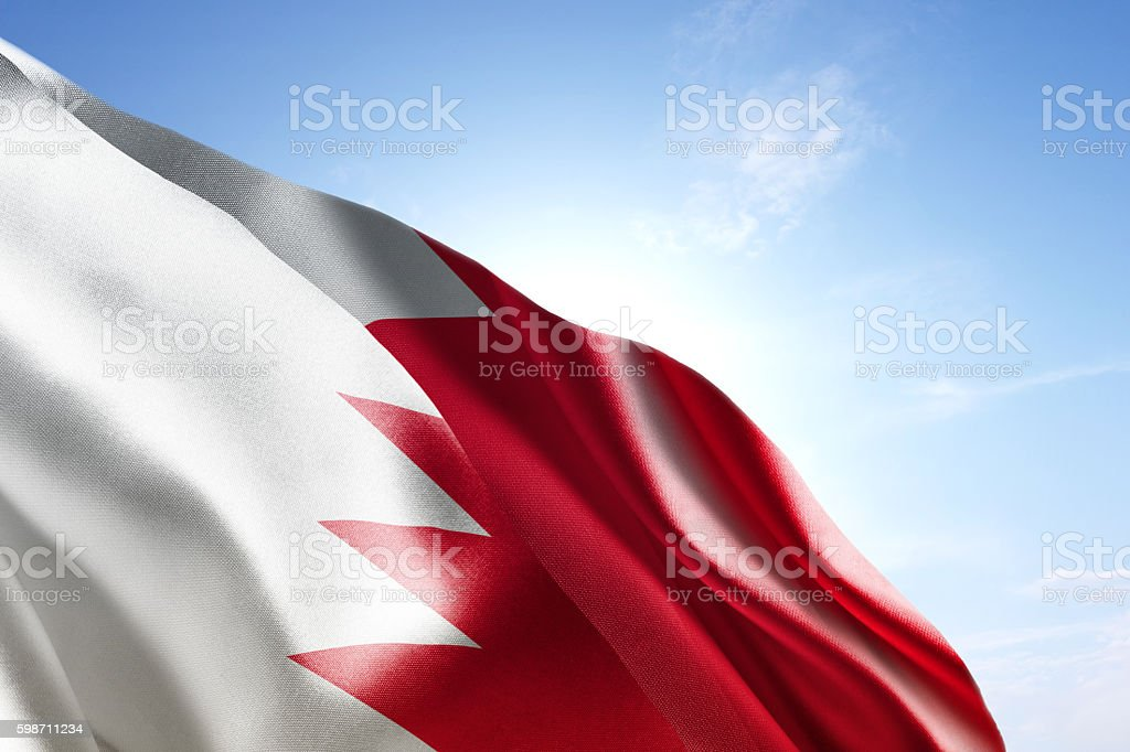 Flag of Bahrain waving in the wind stock photo
