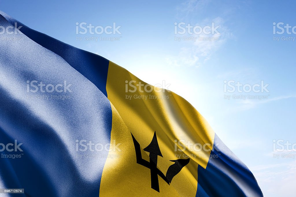 Flag of Barbados waving in the wind stock photo