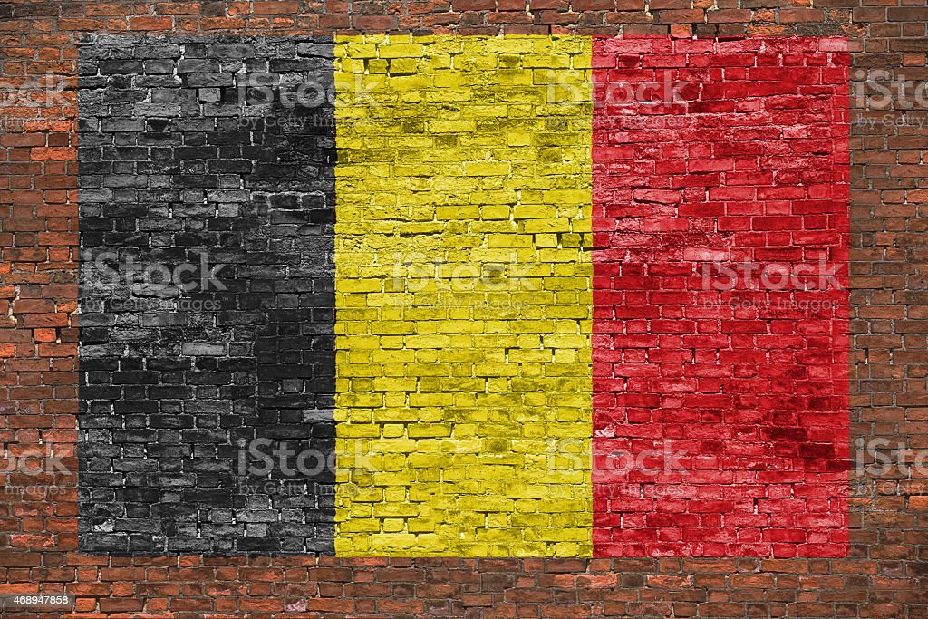 Flag of Belgium on aged brick wall stock photo