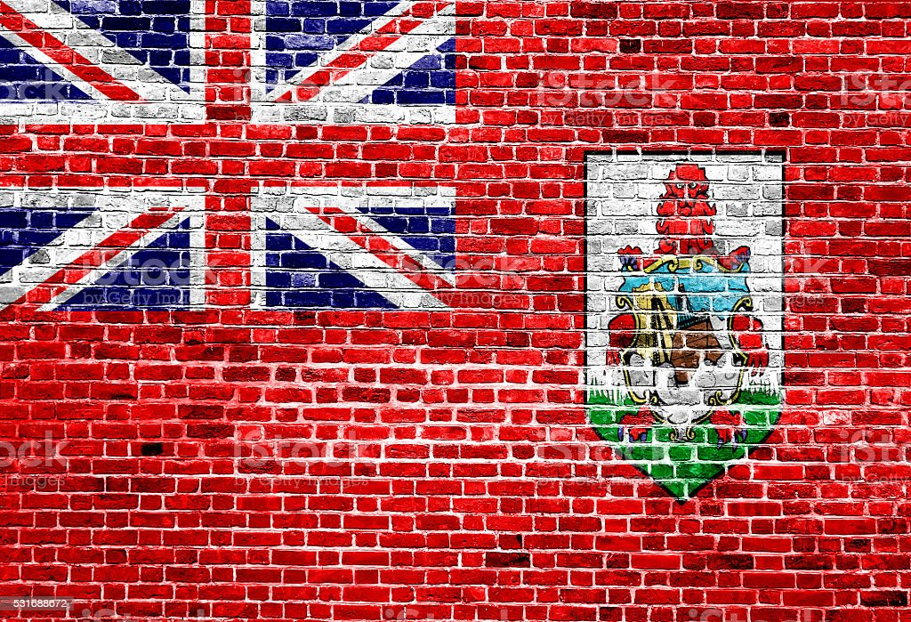Flag of Bermuda painted on brick wall, background texture stock photo